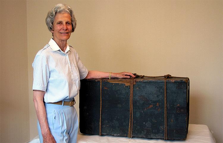 Ruth Klein standing next to Joanna Southcott's Box of Prophecies.